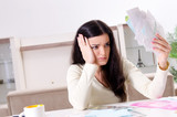 Young woman with receipts in budget planning concept