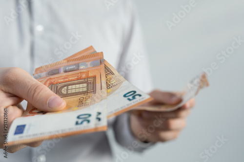 Leinwanddruck Bild Geldscheine in hand