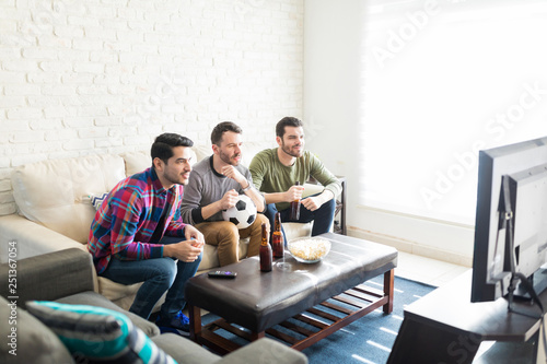 Friends Hanging Out In Living Room And Watching TV
