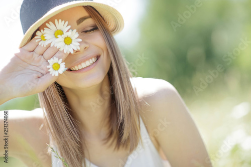 Woman with a flower  - 251374060