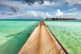 Wooden jetty on the ocean on Maldives Islands.