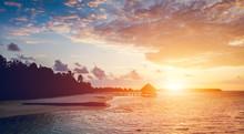 """Постер, картина, фотообои """"Sun setting on a tropical island."""""""