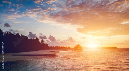 Sun setting on a tropical island.