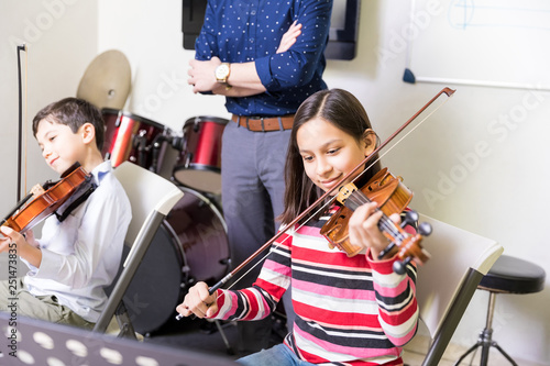 Kids Practicing Some New Sound On A Violin