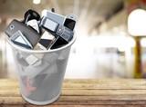 Rubbish bin full of old cellphones