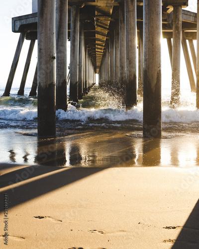 Feet in Sand Under Pier © Kyle