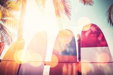 """Постер, картина, фотообои """"Surfboard and palm tree on beach background."""""""