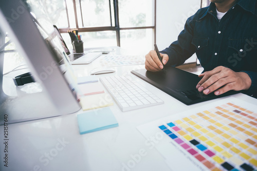 Creative graphic designer using graphics tablet. © ijeab