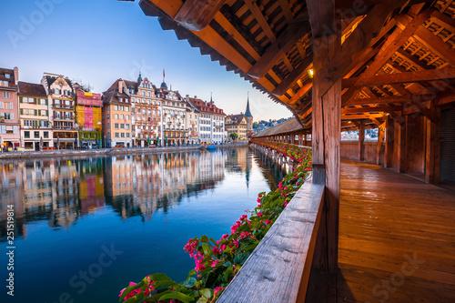 Leinwandbild Motiv Kapellbrucke historic wooden bridge in Luzern and waterfront landmarks dawn view