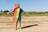 man covered with a rainbow flag