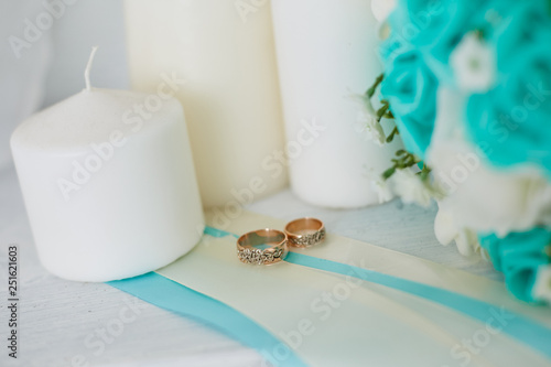 Wedding arrangement. Wedding rings lie next to white candles. © Semenova Jenny