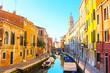 Sunny day in Venice. Narrow streets, canals and beautiful architecture.