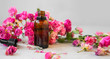 Leinwanddruck Bild - Rose oil. Spa and aromatherapy rose flowers essential oil bottle with pipette