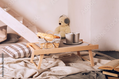 Wooden tray with breakfast on the bed. - 251661047