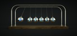 Newton's cradle in motion. With the word Effect written in the spheres.
