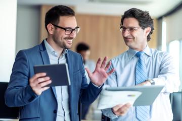 Businessmen discussing document