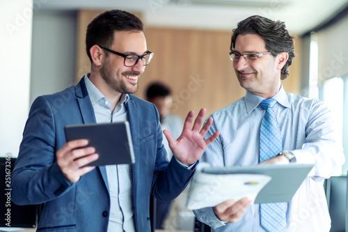 Businessmen discussing document © ivanko80