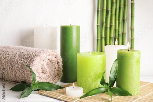 Leinwandbild Motiv Beautiful spa composition with green candles on table