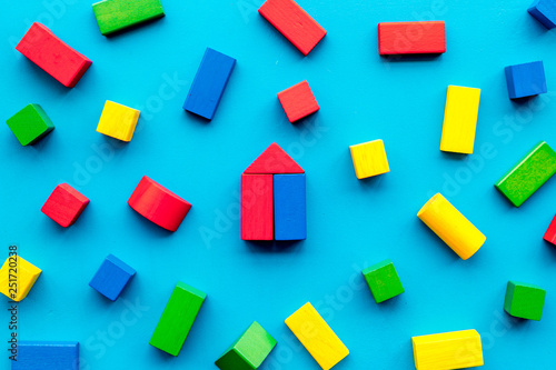 Children background. Wooden building blocks for developing and entertainment on blue background top view - 251720238