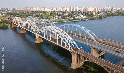 mata magnetyczna Aerial top view of automobile and railroad Darnitsky bridge across Dnieper river from above, Kiev (Kyiv) city skyline, Ukraine