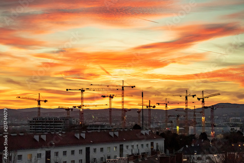 obraz PCV Panoramic view of a sunset over Viennas Wienerberg with a construction site