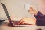 Hands typing on laptop. Business and Financial concept. Double exposure of stock market charts. - 251768283