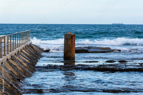 breakwater in the sea protecting an ocean pool © Paskaran