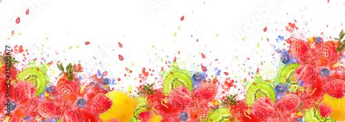 Artfully and lovingly designed fruit explosion banner with raspberries, blackberries, strawberries, kiwis, lemon and water splashes in the background - 251795677