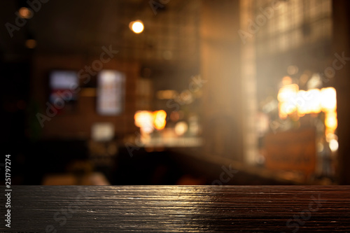 top of black wood with blur light of bar or pub party in the dark night background - 251797274