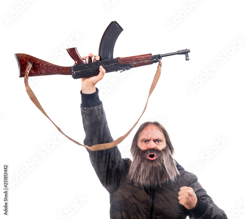 The bearded man rise kalashnikov isolated on a white background. Emotional warrior screaming with automatic weapon. © milkovasa