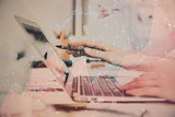 Hands typing on laptop. Business and Financial concept. Double exposure of stock market charts. - 251819222
