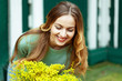close-up woman receives flowers and rejoices and smiles at gift