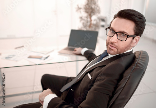 Leinwanddruck Bild responsible businessman sitting at his Desk