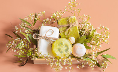 Top view of spa and body care accessories in wooden box on colored background.
