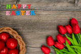 Fototapeta Tulipany - Easter eggs and red tulips © ivanko80