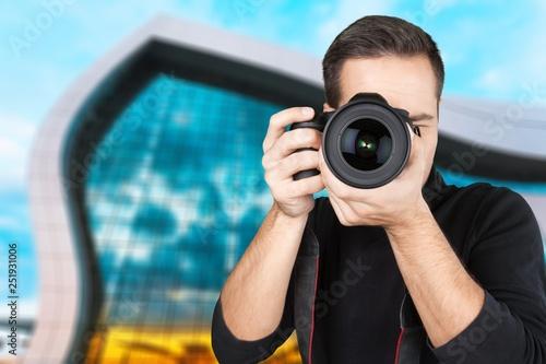 obraz PCV Closeup of a Photographer Taking Photos