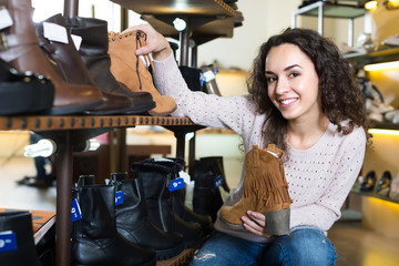 Young woman in a shoe store.