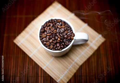 Coffee Cup Full of Fresh Roasted Coffee Beans © he68