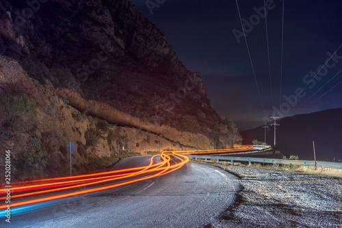 car light trails on serpentine road