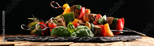 Grilled pork shish or kebab on skewers with vegetables . Food background shashlik - 252032046