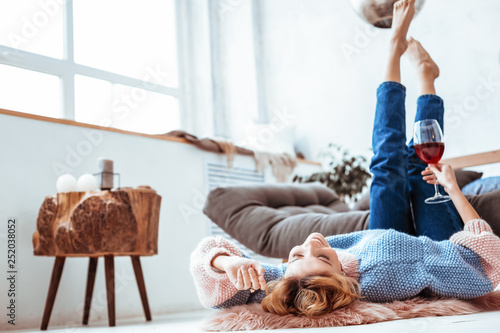 Delighted dreamy woman lying on the floor - 252038052