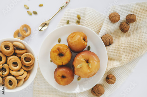 Baked apples on white background. Top view. Still life © tychynska
