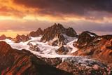 Mountains peaks sunset landscape. Mountain range with orange light