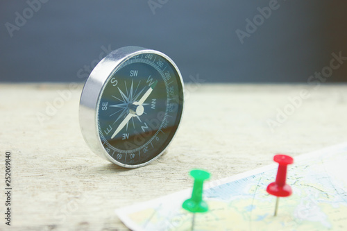 compass and map on the table