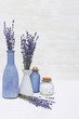 Lavender aromatherapy. Spa background with lavender flowers and essential oil in bottle. Copy space.
