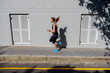 female sprinter running along a road
