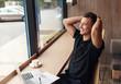 Leinwanddruck Bild - Relaxed businessman sitting in cafe