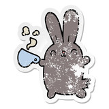 distressed sticker of a cute cartoon rabbit with coffee cup