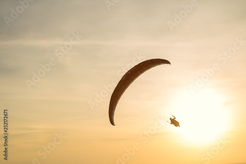 Paraglider silhouette in the sunset sky © phatthanun