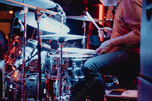 Unrecognizable drummer in concert - 252175020